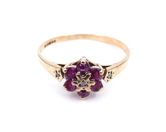 Vintage ruby diamond cluster flower ring, a delicate vintage ruby ring in 9kt gold.