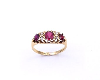 Antique garnet ring, a vintage garnet and diamond ring in an 18kt gold setting.