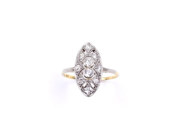 Art Deco style diamond  ring, a marquise shaped ring in an 18 kt gold setting.