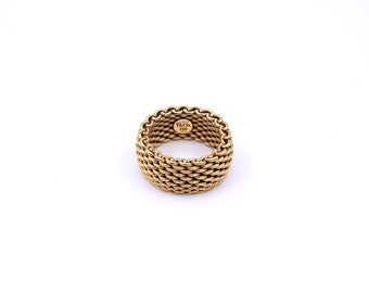 A heavy gold ring by Tiffany & co in 18 carat gold, a flexible gold ring.