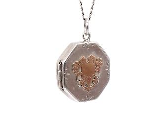 Antique engraved locket, vintage locket in silver with a rose gold motif.