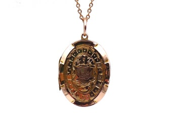 Engraved rose gold antique locket from the Edwardian era.