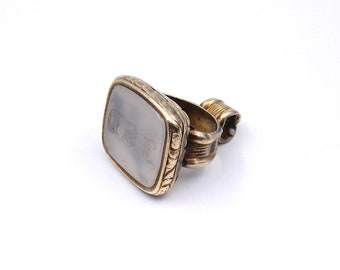 Antique gold plated fob with a chalcedony wax seal, engraved with lettering.
