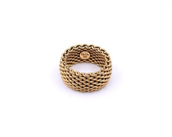 Tiffany & co mesh ring, in 18 carat gold.