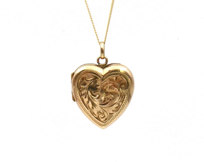 Vintage engraved gold locket with a foliate design, a patterned border and full hallmarks.
