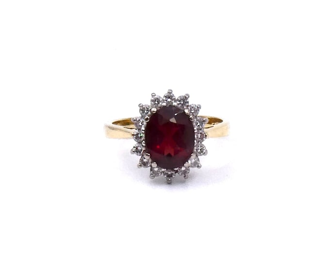 A garnet diamond cluster ring, stunning statement garnet ring in 18kt gold, Ideal January birthstone gift.