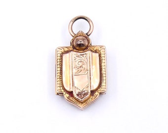 Engraved antique locket in the shape of a shield, with ornate detailing, a 9kt locket.
