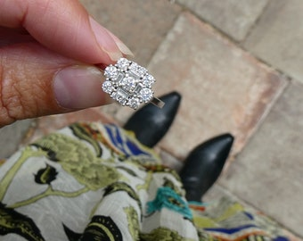 A diamond white gold cluster ring set with baguettes and round diamonds in 18kt white gold.