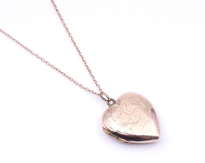 Vintage engraved rose gold locket, an engraved heart shaped back and front gold locket.