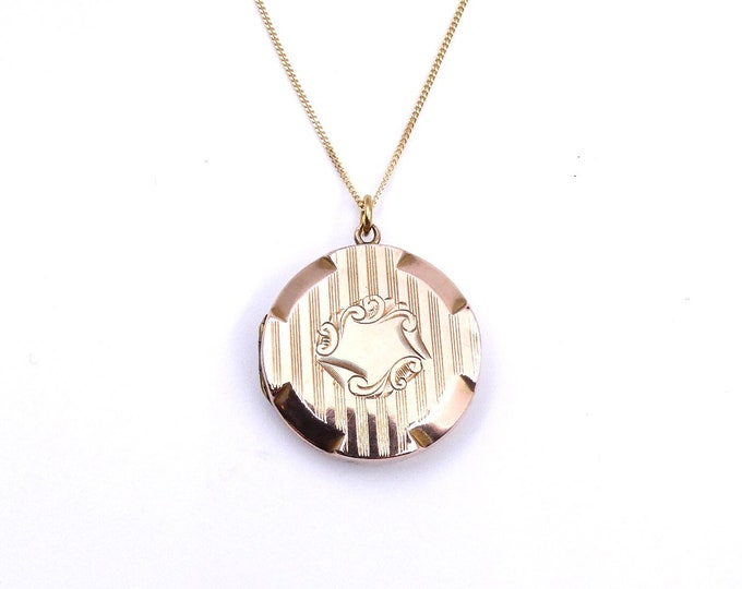 Engraved antique rose gold locket, a round vintage locket with a striped pattern.