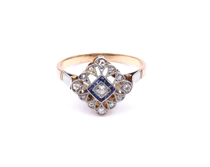 Antique Sapphire ring with diamonds set in platinum with an open work lace settings, Art Deco style sapphire ring.