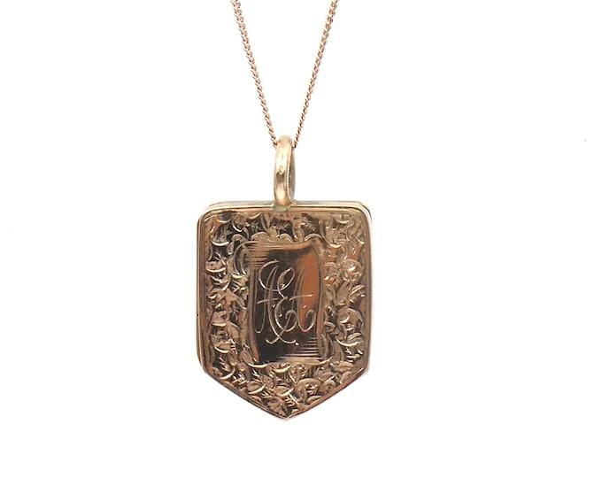 Antique 9kt rose gold engraved locket hallmarked, a shield locket with exquisite leaf and floral motif detailing.