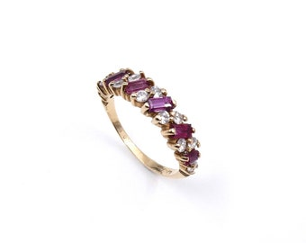 Ruby baguette gold ring, a half eternity ring set in 9kt gold.