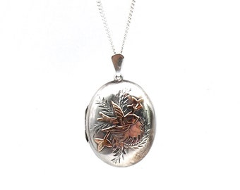 Vintage silver locket with a rose gold bird and leaf motif, hallmarked silver locket engraved and decorative, meaningful vintage gift.