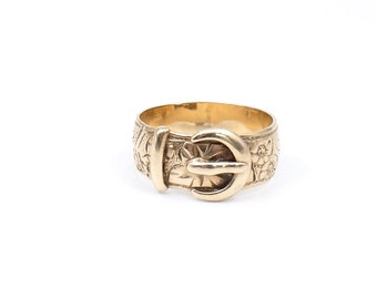Vintage engraved buckle ring, a heavy engraved buckle ring with embossed floral and star motifs.