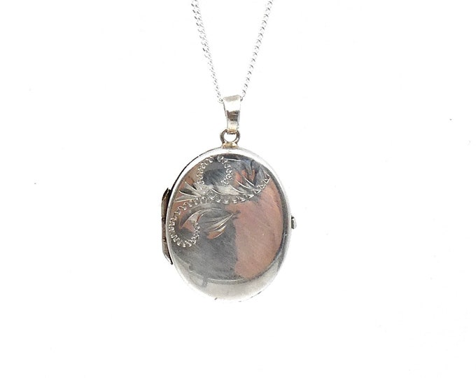Antique engraved locket, silver oval locket with floral engraving.