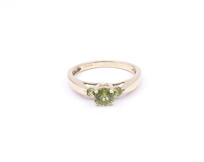 Three stone peridot gold ring, a green gemstone ring, ideal august birthstone ring.