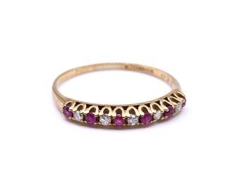 Vintage diamond spinel half eternity ring in 9kt gold.