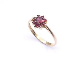 Vintage garnet gold flower ring, a garnet daisy cluster, a delicate and fine ring ideal for a January birthday.