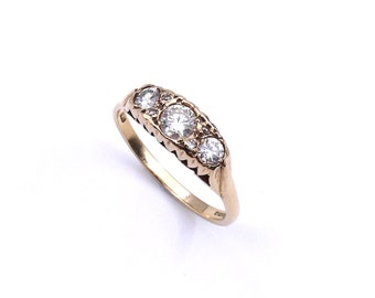 Three stone diamond ring, antique style diamond ring in a raised setting, lovely 9kt gold diamond ring.
