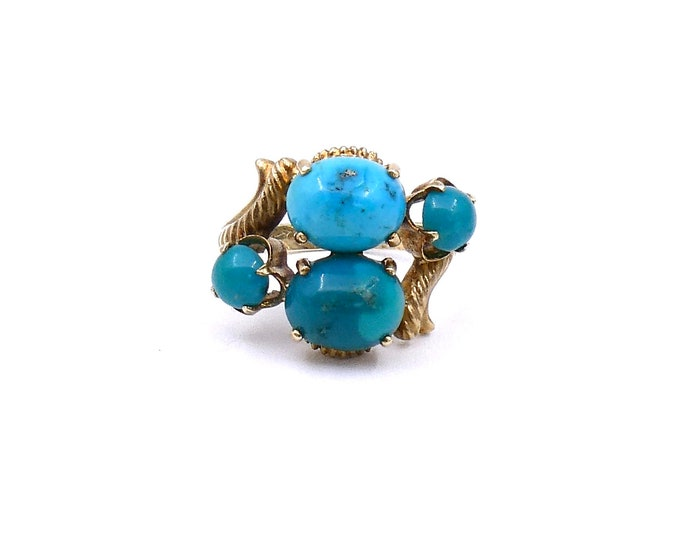 A turquoise statement ring in 14 kt yellow gold.