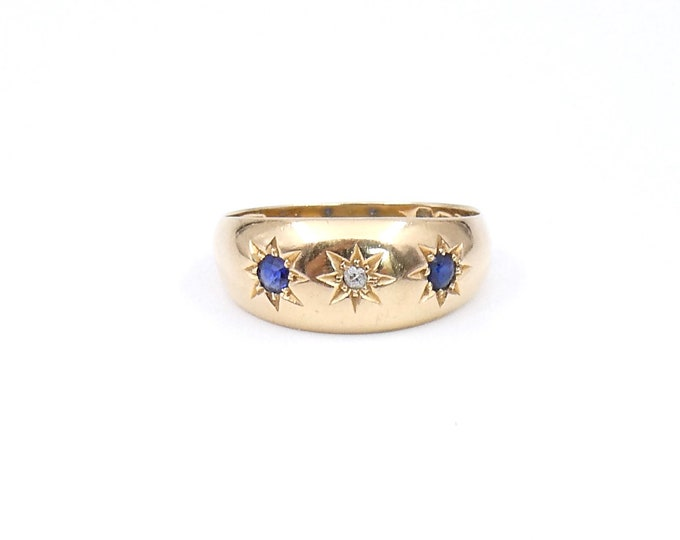 Sapphire diamond gypsy ring in 18kt gold, a domed gypsy star set ring with rich blue sapphires and diamond.