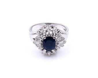 A sapphire and diamond white gold cluster ring, a retro style ring with tapered diamond baguettes.