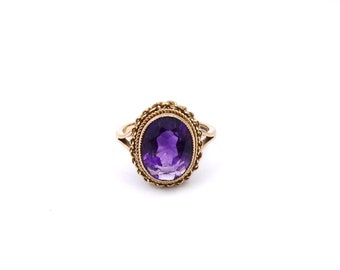 Vintage amethyst ring, purple gemstone ring with a twisted gold wirework setting on a heavy gold band, amethyst solitaire.