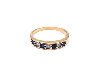 A sapphire and diamond half eternity band.