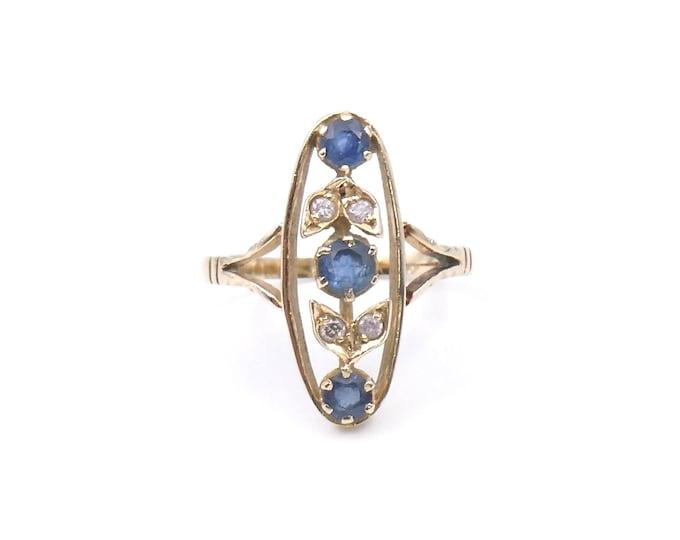 Sapphire diamond navette shaped ring, vintage sapphire ring with diamond set leaf motifs, elegant vintage ring.