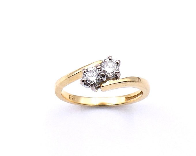 Vintage diamond ring, a diamond promise ring,  a two stone diamond twist ring in 18kt gold.