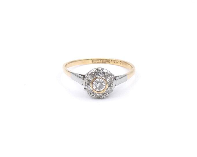 Vintage diamond flower ring, in 18kt gold and platinum.