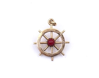 vintage gold pendant 18kt gold, nautical gold pendant, a beautifully made ship's wheel, unusual vintage gold pendant.