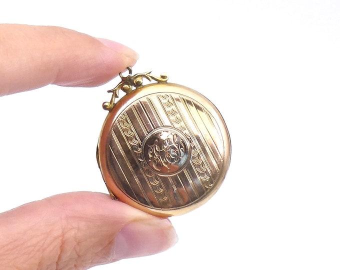 Antique round gold locket, patterned pin stripe large 9kt back and front gold locket.