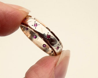 Vintage ruby gold ring, an eternity style ruby band with unusual patterning and two toned gold, ideal July birthstone ring.
