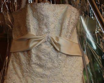 """New size 10 Maggie Sottero's couture wedding gown, champagne color, strapless, cathedral double train, buttons & zipper """"genevieve""""."""