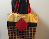 Plaid Quilted Tote with diagonal red pockets