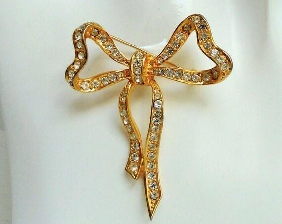 Large vintage gold metal glass diamante bow design brooch (Sphinx)