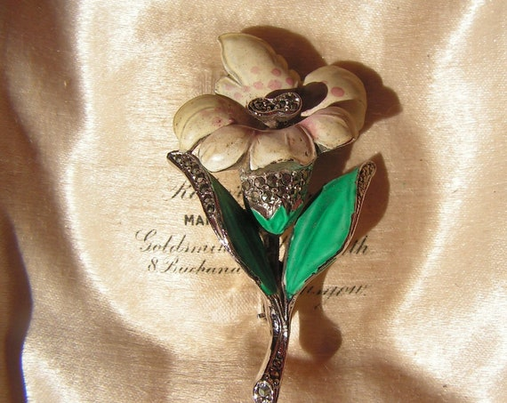 A pretty  vintage enamel marchasite orchid flower brooch