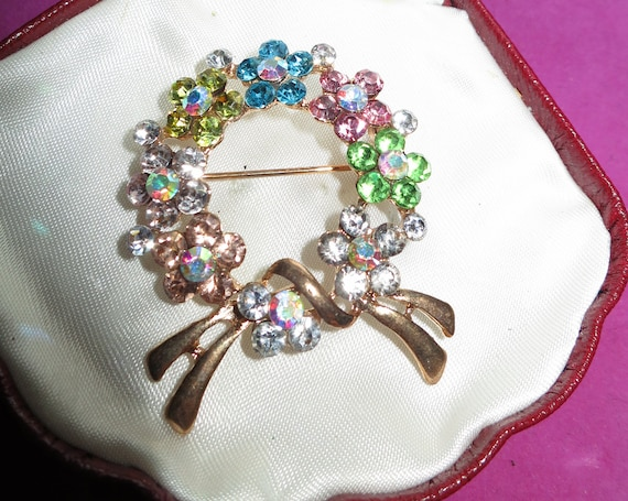 Beautiful Vintage  Goldtone multi colour diamante garland brooch