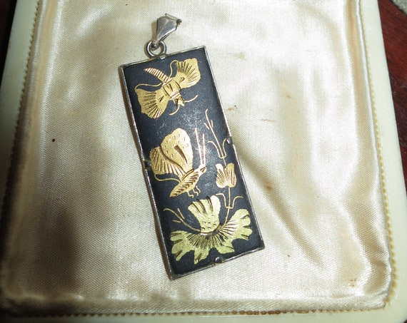 Delightful vintage damascene goldtone butterfly motif pendant