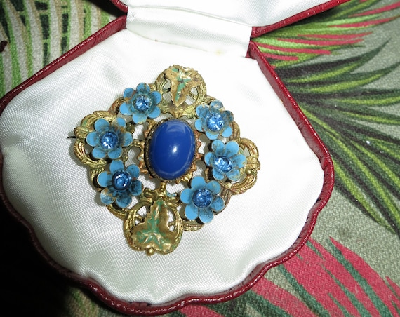 Lovely vintage Czech gold metal filigree floral brooch with lapis blue glass cabochon
