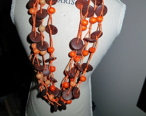 Lovely vintage retro resort style orange and wooden beaded necklace