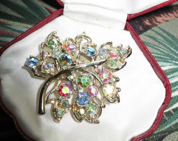 Fabulous vintage Hollywood goldtone rainbow aurora borealis glass maple leaf brooch