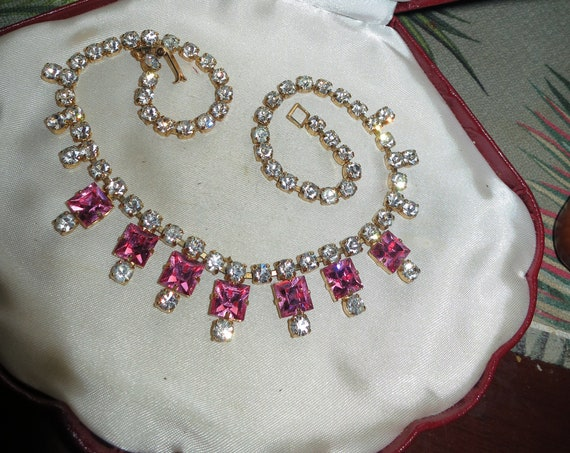 Gorgeous vintage goldtone clear and pink foiled glass rhinestone necklace