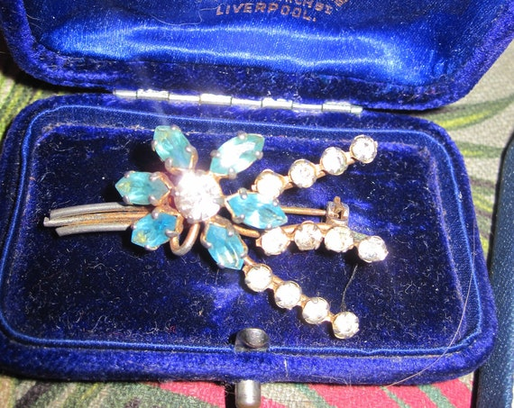 Charming vintage gold metal clear and blue glass rhinestone brooch