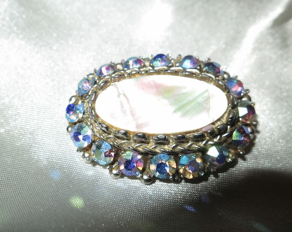 Lovely Vintage 1940s mother of pearl blue AB rhinestone brooch