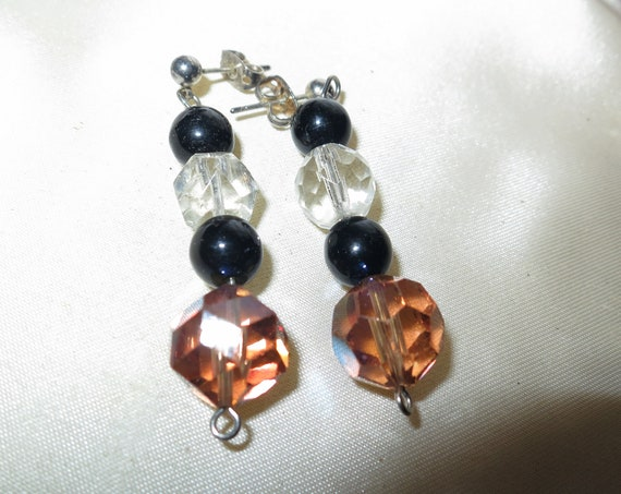 Fabulous pair of vintage black and clear and amber AB glass stud earrings