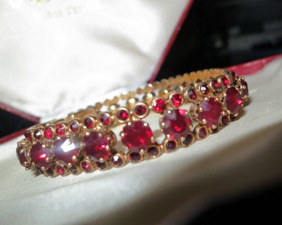 Lovely vintage gold metal garnet rhinestone bangle bracelet with safety chain