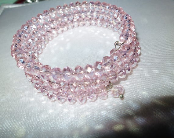 Lovely pink aurora borealis glass wrap bracelet